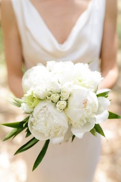 All-white floral wedding bouquet, tiny white roses, classic bridal style, pin to your own inspiration board // Simone Anne Photography