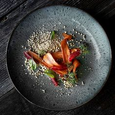 These carrots have been pan roasted and smoked. They rest on a pilpelchuma cashew soil with blood orange and toasted buckwheat. I also had a roasted blood orange-cultured almond cream with it. I made that with some of the thick Italian almond milk I made