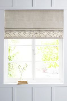 Embroidered roman blinds - I like the edging More