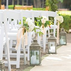 The aisle will have alternating white lanterns with candles and shepherds hooks with hanging mason jars filled with white hydrangeas, bay laurel, jasmine vine, dusty miller, white waxflowers, and ivory roses.