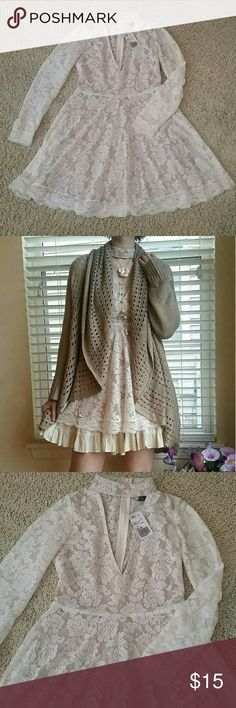 Cute Forever 21 Lace Choker Long Sleeve Mori Dress A gorgeous V neck lace dress with floral patterning and beige lining. Only worn once for the photo, but still has tags and is in perfect condition. Size small from Forever 21. ***All purchases come with a free gift! Forever 21 Dresses