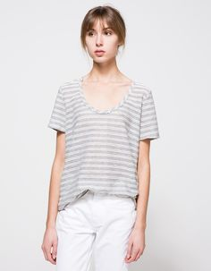 From Which We Want, a lightweight tee in grey and white stripes.  Features wide round neckline, short capped sleeves, allover texture and relaxed fit.  •Lightweight tee in grey stripes •Wide, round neckline •Short capped sleeves •Allover stripe t