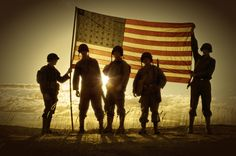 WWII Soldiers Standing In A Flag Draped Sunset