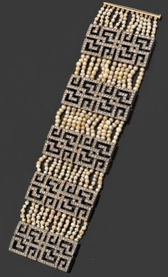 A Belle Époque pearl, diamond and gold bracelet, French, circa 1910. Consisting of twelve rows of natural seed pearls connected by five Greek key motifs set with rose-cut diamonds, mounted in gold.
