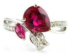 Vintage Rose Red Ruby Ring Silver Rings Paving the way to unique jewelry trends, this vintage style 925 sterling silver gemstone ring features pear cut red rubies & clear crystals Vintage Style, Vintage Fashion, Pave Ring, Rose Design, Vintage Roses, Jewelry Trends, Clear Crystal, Red Roses, Pear