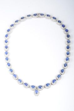 The necklace features 35 oval sapphires weighing approximately 28 carats, and 560 round diamonds weighing approximately 7.8 carats, mounted in 14K white gold; bracelet is comprised of 17 oval sapphires weighing approximately 9.35 carats, and 221 round-cut diamonds weighing approximately 2.55 carats, mounted in 14K white gold; necklace length 16 1/2 inches, weight 46.1g; bracelet length 7 1/2 inches, weight 21.9g.
