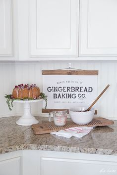 Christmas Home Tour | Holiday Housewalk 2016 - Ella Claire Shop, gingerbread baking sign, pretty little Christmas cake, kitchen styling, kitchen decor, white and wood, Christmas baking