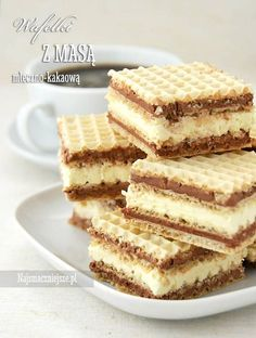 """Wafelki z masą z mleka w proszku OK, I can't even READ the recipe - but I KNOW it's easy! I wanted the photograph mostly. Basically, it's a wafer, then a filling and repeat! BUT I saw my Polish mom-in-law doing """"something"""" with the wafers first and will find out what! (wrapping them in damp cloth to make them softer!) Wrap in plastic when assembled and cut when completely COLD. YUMMY!"""