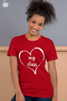 Show your class love with this subtle Valentine's Day teacher tee- perfect for January and February! Whether you're looking for a new teacher t-shirt for your collection for any day of the year, or for Valentine's Day parties, this shirt is perfect for elementary school teachers and preschool teachers. It's available in several colors in this flattering Bella Canvas style.