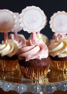 Mini cupcakes in gold wrappers at a pink and gold Baby Shower! See more party ideas at CatchMyParty.com!