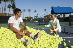 Hmm, I wonder how many ball kids were needed at this practice session...
