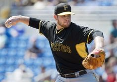 Pittsburgh Pirates starting pitcher Casey Sadler works against the Toronto Blue Jays during first inning Grapefruit League baseball action in Dunedin, Fla., on Sunday, March 8, 2015. (AP Photo/The Canadian Press, Nathan Denette)