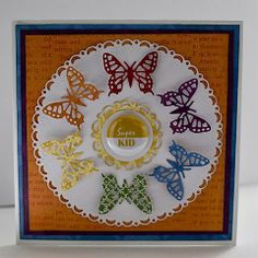 For a simple quick card for a child's birthday you cant got wrong with butterflies and rainbows… I have die cut a butterfly in each colour of the rainbow and placed them in a circle inside the Horizon Circle Boutique Stacker Frames – DL272  then topped it with a little tin badge. #cheeryld #susanspinningit Dies used: Small Exotic Butterflies # 1 w/Angel Wings – DL112AB; Horizon Circle Boutique Stacker Frames – DL272 http://www.cheerylynndesigns.com