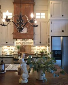Farmhouse kitchen with stacked cabinets, brick backsplash and DIY reclaimed wood hood. We have used many reclaimed pieces.the oven hood is two vintage do Kitchen Redo, Kitchen Styling, New Kitchen, Kitchen Ideas, Kitchen Sinks, Kitchen Brick, Warm Kitchen, Kitchen Cabinets, Kitchen Designs