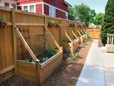 Container Vegetable Gardening 101 - Farm and Garden - GRIT Magazine. A privacy fence serves as one side of these small container boxes. A yard doesn't need a lot of room in order to hold boxes filled with delicious produce. Photo by Joseph Kreiss #containervegetablegardeningideas