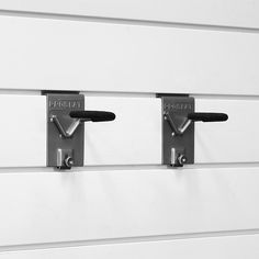 Proslat 2-Pack Vertical Locking Bike Hook In Silver - Free up valuable floor space by hanging bicycles securely on the wall with Proslat Vertical Bike Hooks. Each hook is made of heavy-duty, welded steel with rubber tips that won't harm or scratch gear being hung. For use with Proslat wall panels only.