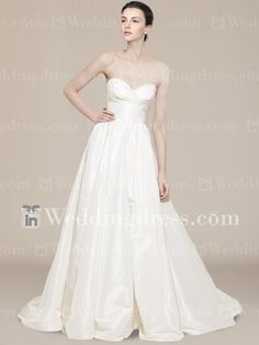 Taffeta strapless gown with sweetheart neckline, flower pin at the back and full skirt. Chapel Train for spiffy finishing. Good option as a destination wedding dress.