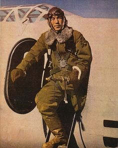 A Japanese army air force pilot with his Mitsubishi Ki-21 bomber aircraft, 1942.