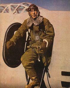 A Japanese army air force pilot with his Mitsubishi Ki-21 bomber aircraft, 1942.