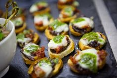 Crostini, with red onion jam, sun blush tomato, mozzarella and pesto - wedding canapes - slate food - nibbles - party food - event food