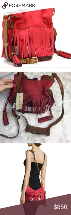 """NWT Burberry fringe cross body bucket bag Brand new with tags attached Burberry Smooth Nubuck Trimmed Check Canvas With Polished Goldtone Hardware comes with dust bag  Fringe Trim Throughout; Drawstring Tassel At Sides Inset Magnetic Snap Closure Adjustable 40"""" Shoulder Strap With Shoulder Rest And 22"""" Drop Interior Features Canvas Lining Measures Approximately 12'' At Widest X 9½'' Tall At Center X 5½'' Deep Burberry Bags Crossbody Bags"""