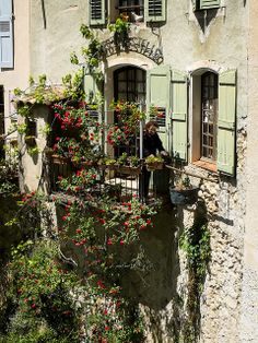 Rose-Covered Balcony in Moustiers | Flickr - Photo Sharing!  And it overlooks a stream  that runs through the town!