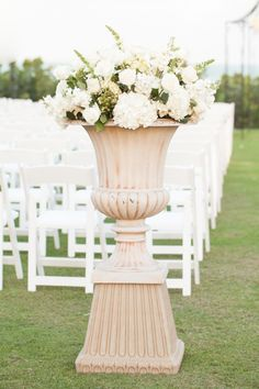 Aisle decor. William Bainbridge Steele Floral Designs. Photography: Amalie Orrange Photography - www.AmalieOrrangePhotography.com  Read More: http://www.stylemepretty.com/florida-weddings/vero-beach/2013/12/31/johns-island-club-wedding/