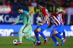 Lionel Messi (L) of FC Barcelona competes for the ball with Nicolas Gaitan (2ndL) of Atletico de Madrid and his teammate Filipe Luis (R) during the Copa del Rey semi-final first leg match between Club Atletico de Madrid and FC Barcelona at Estadio Vicente Calderon on February 1, 2017 in Madrid, Spain.