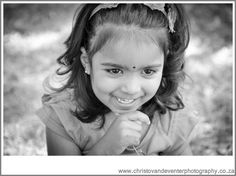 An image of a cute little girl from beautifully relaxed family photographs Delta Park.