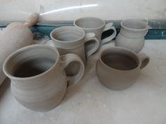 Mugs drying before bisque firing