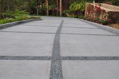 Large charcoal black standing pebble tile driveway accents