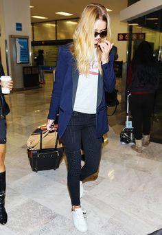 Rosie Huntington-Whitely wearing a structured blazer + t-shirt and cropped pants at the airport