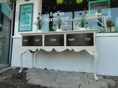 This buffet was painted in a cream and then the drawers were stained a rich walnut with rustic looking hardware!