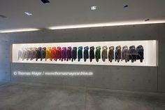Generational illuminated wall display -- SHOPLIFTER Duvetica Milano Shop / Tadao Ando