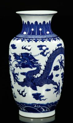 Chinese Blue and White Porcelain Dragon Vase. Blue and white porcelain vase, China, with a flying dragon design on a cloud background, Qing Qianlong mark on base.