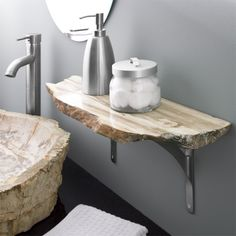 stone bathroom shelf - beautiful contrast between the clean lines of the machined shelf supports and the raw stone edge.