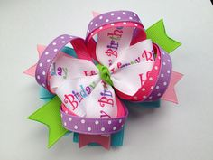 Happy Birthday Hair Bow -- Boutique Layered Birthday Hair Bow: Pink, Purple, Lime Green, Blue. $8.25, via Etsy.
