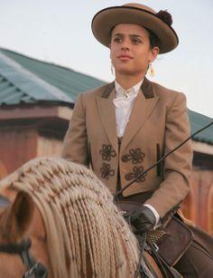 A lady promenades in her Portuguese riding costume; Golega Horse Festival, Portugal.