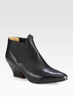 Acne - Alma Leather Ankle Boots - Saks.com    At first look, these seem to be a decent pair of basic lil' black booties. But I think they might look like elf shoes or colonial shoes or something from a costume on... am I the only one who sees that?