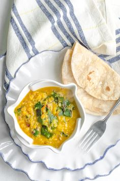 Dal and roti are staple foods in every Indian household. Growing up, mine was no different, and I've carried on the tradition with my own family. I love the ease of this simple, rustic weeknight meal and the convenience of making and freezing rotis in advance. I also ratchet up the healthy heartiness of this meal by adding whatever greens I happen to have on hand.