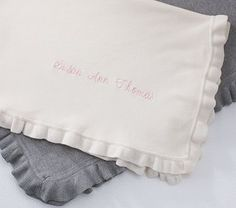 Rose Throw Blanket #PotteryBarnKids - Ivory with ligth pink monogram.... SO soft!... and perfect for a toddler in between baby blanket and twin size blanket.