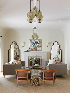 The living room exhibits Prevezanos' ethos of symmetry. Here, almost everything in the space, right down to the pillows on the matching loveseats, has a twin | archdigest.com