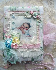 Absolutely breathtaking handmade baby card. Lots of shabby chic goodness on this one with layers upon luscious layers of gorgeous laces, flowers, pearls, etc. Much attention to details on this. ~Love~
