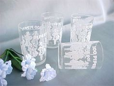 Great barware advertising, here is a set of four mid centuryshooters or jiggers…