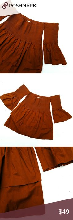NWOT NYTT Burnt Orange Off the Shoulder Top NWOT NYTT Burnt Orange Off the Shoulder Bell Sleeve Bohemian Festival Top 20 in long Excellent, new (never worn) condition. Feel free to ask me any additional questions. No trades or modeling. Happy Poshing! NYTT Tops