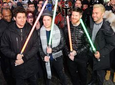 Fall Out Boy from The Big Picture: Today's Hot Pics  Band members Joe Trohman, Pete Wentz, Patrick Stump and Andy Hurley play with lightsabers outside the Good Morning America studio in NYC.