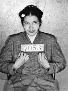 Rosa Parks arrested for her refusal to give up her seat on a bus to a white woman, which sparked the Civil Rights Movement