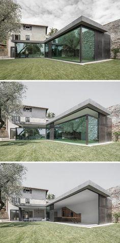Versenkbare Glaswände schaffen die Grenzen zwischen Haus und Garten ab