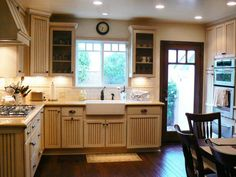 See a beige cottage kitchen with rustic wood floors on HGTV.com.