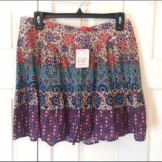 NWT Chelsea & violet skirt New with tag! Size Large.  The last pic is the back of the skirt. Chelsea & Violet Skirts